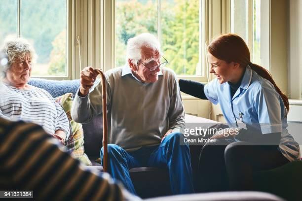 Nurse visiting elderly patients at home