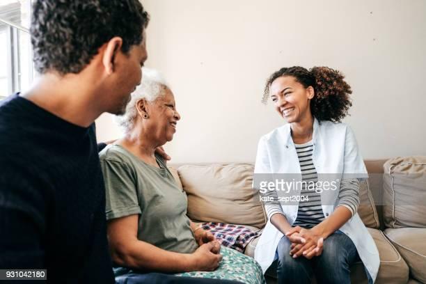 Nurse visiting senior lady at home