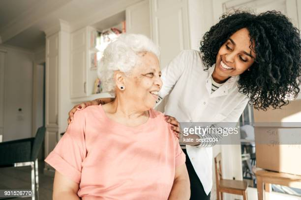 Nurse visiting senior lady at home