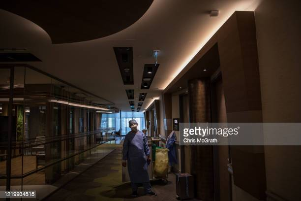 A nurse waits to enter the room of a patient recovering from the COVID19 virus in the COVID19 inpatient ward at the Acibadem Altunizade Hospital on...