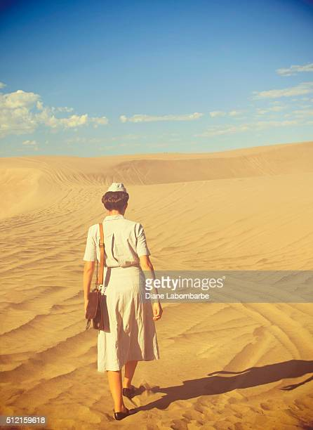 WWII Nurse Walking Away From The Camera In The Desert