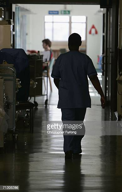A nurse walks between wards at The Queen Elizabeth Hospital Birmingham on June 14 Birmingham England Senior managers of the NHS have said that the...