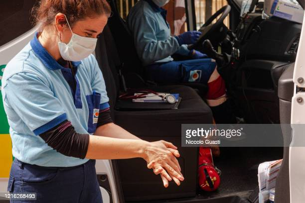 Nurse washes her hands after an operation on March 23 2020 in Seville Spain Spain will forbid all nonessential economic activity until April 9 as...