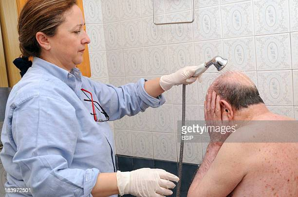 Nurse Washing Elderly Person Toilette Of A Patient Presenting An Alteration Of Mobility Motor Handicap Following A Cerebral Vascular Accident