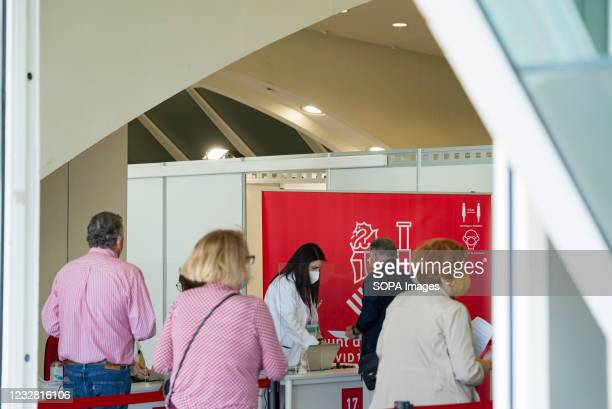 Nurse wearing a face mask attends to people who have come to get vaccinated at the City of Arts and Sciences of Valencia. The good rate of...