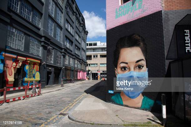 Nurse wearing a face mask virus street art in Shoreditch as lockdown continues and people observe the stay at home message in the capital on 12th May...