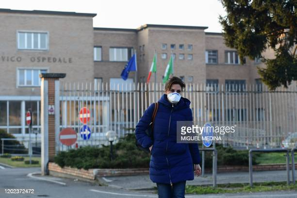 Nurse wearing a protective repiratory mask leaves the municipal hospital in Codogno, southeast of Milan, on February 22, 2020. - An Italian man...