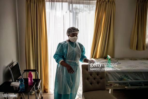 Nurse wearing personal protective equipment is seen at Casa Serena, an Old Age home in Johannesburg, on July 22, 2020. - Senior residents of the old...