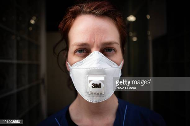 A nurse wears a face mask as a precaution against transmission of the coronavirus on March 12 2020 in Madrid Spain Yesterday known cases of Covid19...