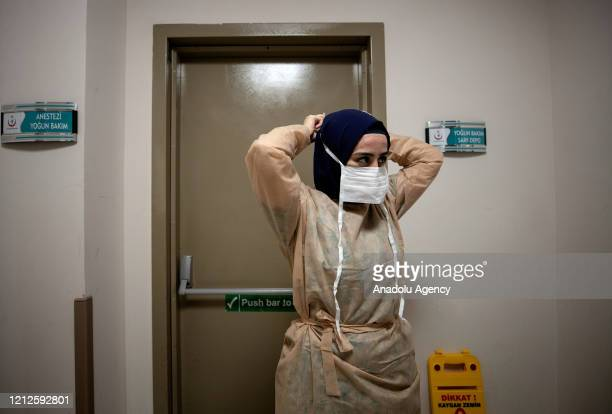 A nurse wears her protective suits to take care of coronavirus patients and suspected ones in emergency unit ahead of the International Nurses Day...