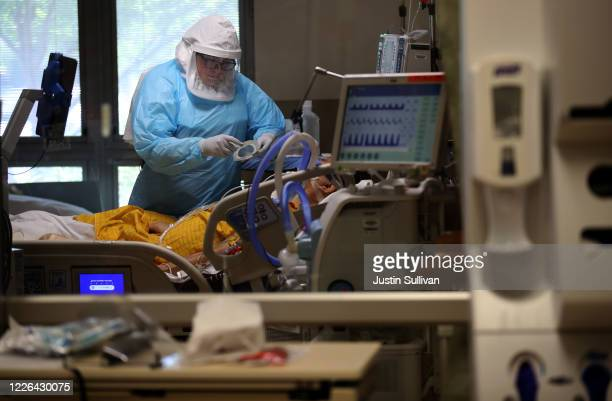 A nurse wears personal protective equipment as she cares for a coronavirus COVID19 patient in the intensive care unit at Regional Medical Center on...