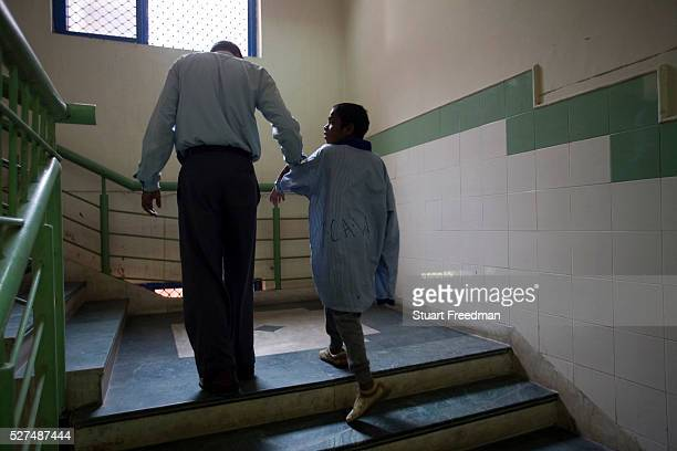 A nurse with a mentally ill child who was abandoned on the streets of Delhi at the Institute of Human Behaviour and Allied Sciences The department of...