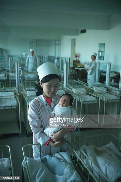 A nurse with a new born baby at Pyongyang Maternity Hospital Only selected patients are treated at this high class hospital