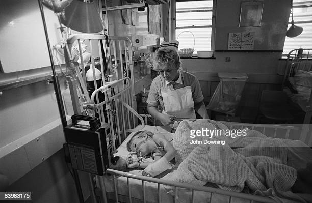 A nurse with a young patient at Great Ormond Street Hospital London December 1987 The hospital specialises in the care of children