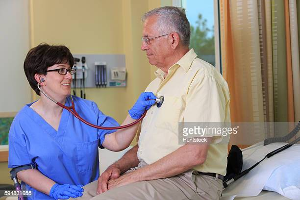 Nurse with Cerebral Palsy checking a patients heart in a clinic