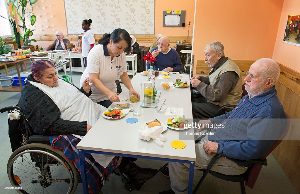 Nurse with elderly in a culturally specific care center on
