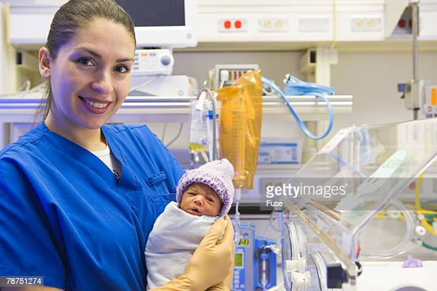 nurse with premature baby - mismatched clothes stock pictures, royalty-free photos & images