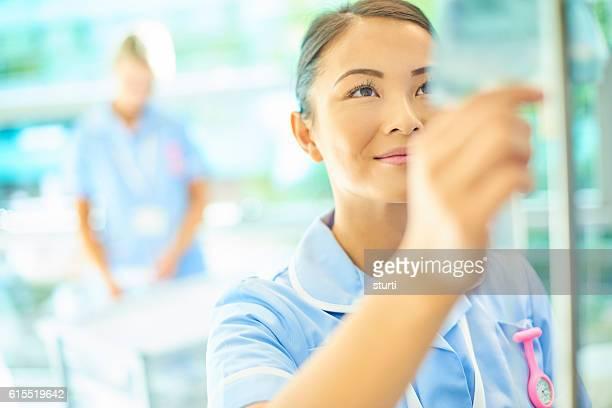 nurse with saline drip