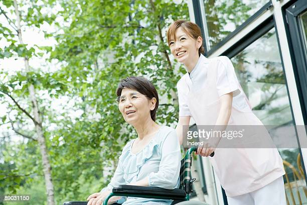 Nurse with senior woman in wheelchair