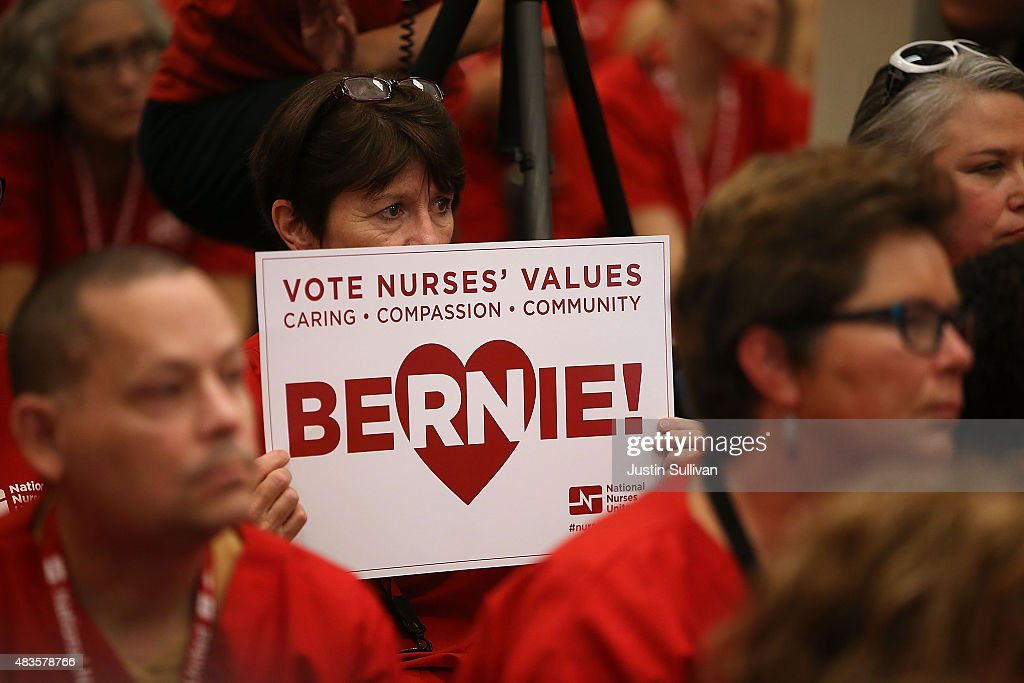 A nurse with the National Nurses United holds a campaign sign as Independent presidential candidate U.S. Sen. Bernie Sanders (I-VT) speaks during the 'Brunch with Bernie' campaign rally at the National Nurses United offices on August 10, 2015 in Oakland, California. The National Nurses United members announced their endorsement for independent presedential candidate Sen. Bernie Sanders during a campaign stop before he heads to Los Angeles for a campaign rally in Los Angeles at the Memorial Sports Arena.