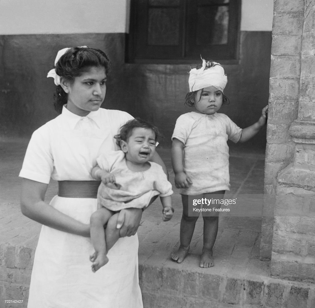 A nurse with two child victims of communal violence in Amritsar Punjab during the Partition of British India March 1947 The children`s mother was...