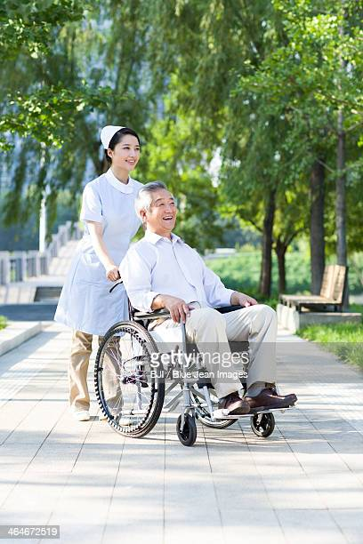 Nurse with wheelchair bound patient