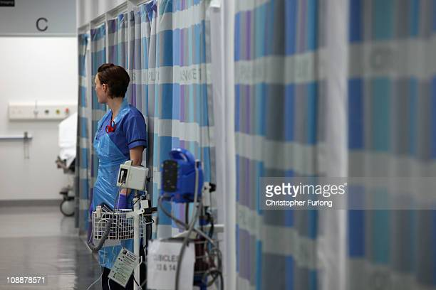 A nurse works in the busy Accident and Emergency department of the recently opened Birmingham Queen Elizabeth Hospital attends a work station on...