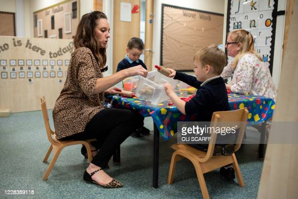 Nursery and pre-school pupils play and learn at a table at Willowpark Primary Academy in Oldham, northern England on September 7, 2020. - Millions of...