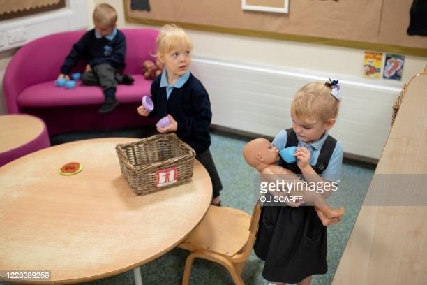 Nursery and pre-school pupils play and learn at Willowpark Primary Academy in Oldham, northern England on September 7, 2020. - Millions of children...