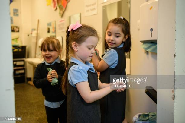 Nursery children wash their hands in order to minimise the risk of passing on Coronavirus at Willowpark Primary Academy in Oldham, north-west England...
