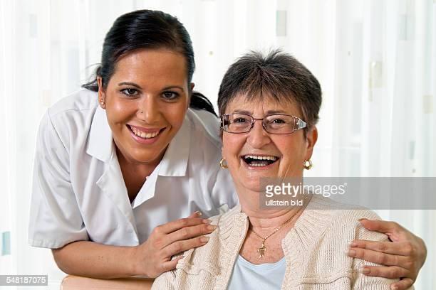 nursery geriatric care nurse with patient