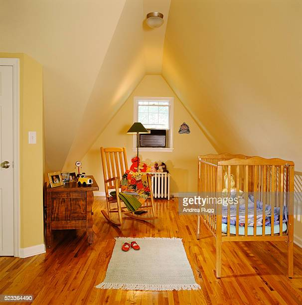 nursery in attic room - nursery bedroom stock pictures, royalty-free photos & images