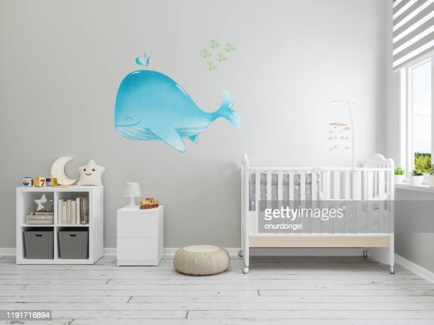 nursery interior with whale wallpaper on the wall - nursery bedroom stock pictures, royalty-free photos & images