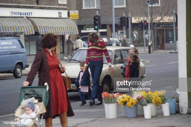 Nursery school assistant Lady Diana Spencer with children from the Young England kindergarten Pimlico London January 1981