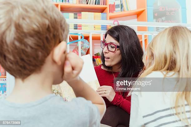 nursery teacher reading a story