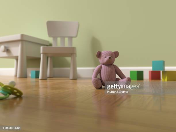 nursery with teddy bear and toys - child behind bars stock pictures, royalty-free photos & images
