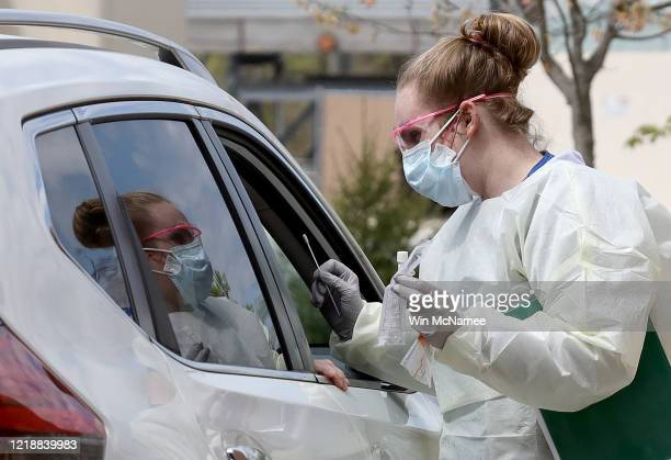 Nurses administer coronavirus testing at a driveup facility at MedStar St Mary's Hospital April 14 2020 in Leonardtown Maryland MedStar St Mary's...