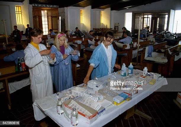 Nurses and assistants prepare medical treatments in a makeshift hospital set in a converted church in Nova Bila a Croatian enclave in central Bosnia...