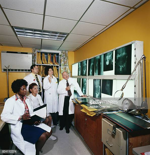 Nurses and doctors at Pelham Bay General Hospital examine a patient's xray