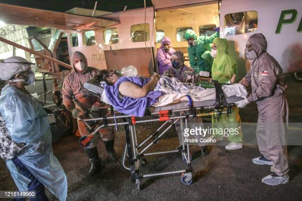 Nurses and doctors rescue a woman in critical conditions after being infected by coronavirus from the airplane that took her from Parintins city to...