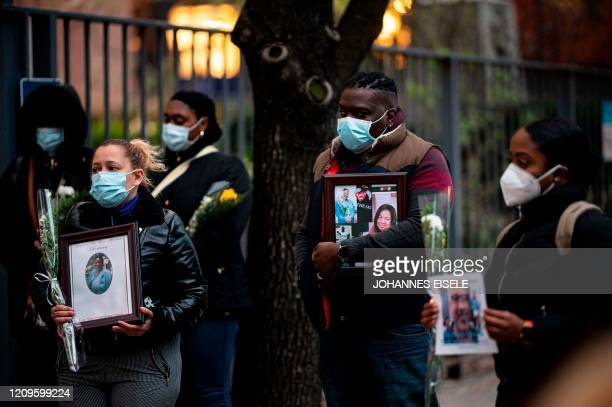 Nurses and healthcare workers mourn and remember their colleagues who died during the outbreak of the novel coronavirus during a demonstration...