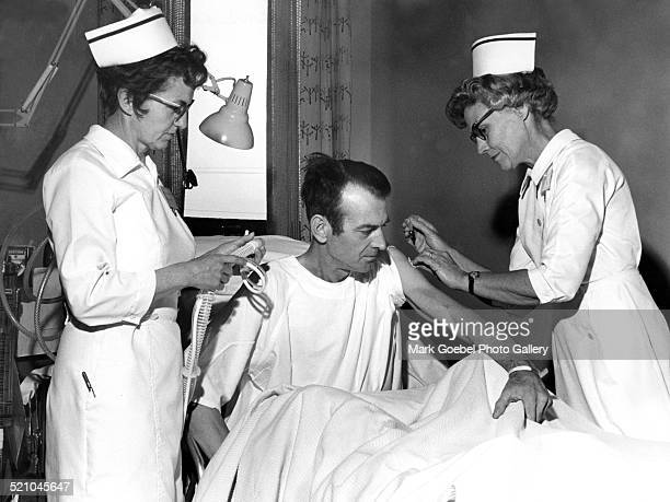 Nurses and hospital patient late 1960s