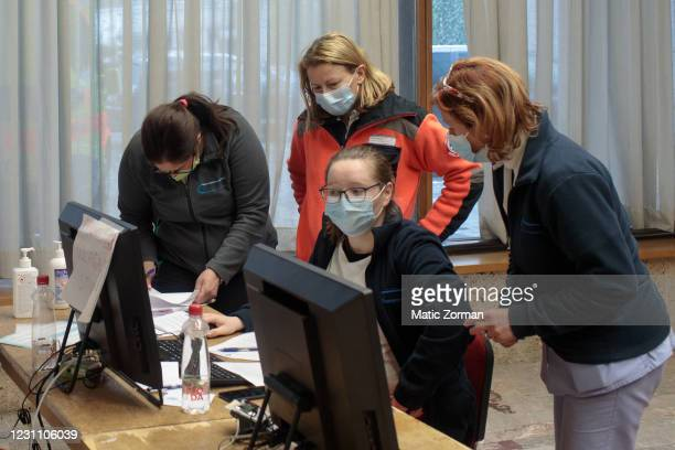 Nurses and members of the vaccination team finish their shift in a vaccination centre on February 11, 2021 in Kranj, Slovenia. Slovenia plans to...
