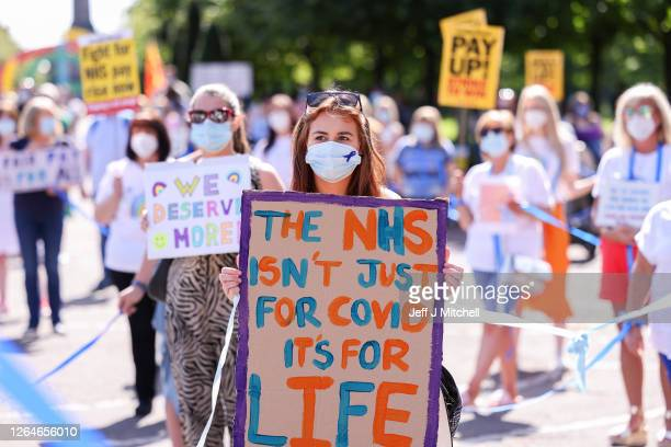 Nurses and other frontline NHS workers stage a protest Glasgow Green after being left out of a public sector pay rise on August 08, 2020 in Glasgow,...
