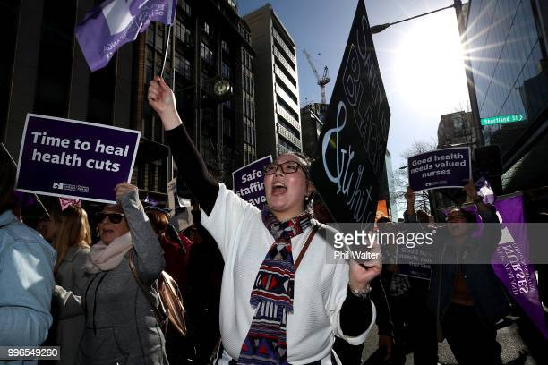 Nurses and Workers Union Members march up Queen Street on July 12 2018 in Auckland New Zealand Thousands of nurses voted to walk off the job for the...