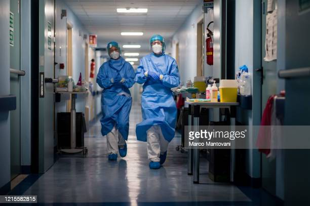 Nurses are walking down the hall at Cremona Hospital on March 29 2020 in Cremona Italy The Italian government continues to enforce the nationwide...