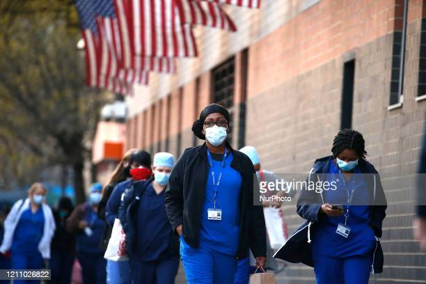 Nurses arrive to Elmhurst Hospital in New York US on April 25 2020 Elmhurst Hospital Trauma Center In Queens Borough of New York City Continues...
