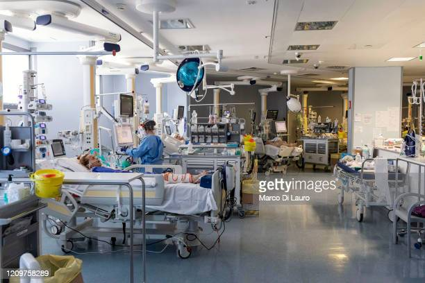 Nurses attend to a COVID-19 patient at the Intensive Care Unit of the Pope John XXIII Hospital on April 7, 2020 in Bergamo, Italy. The number of new...