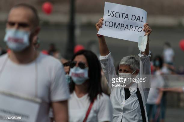 Nurses belonging to Movimento Nazionale Infermieri practice social distancing as they gather to protest for better working conditions following the...