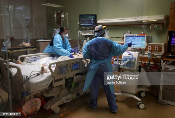 Nurses care for a coronavirus COVID19 patient in the intensive care unit at Regional Medical Center on May 21 2020 in San Jose California Frontline...